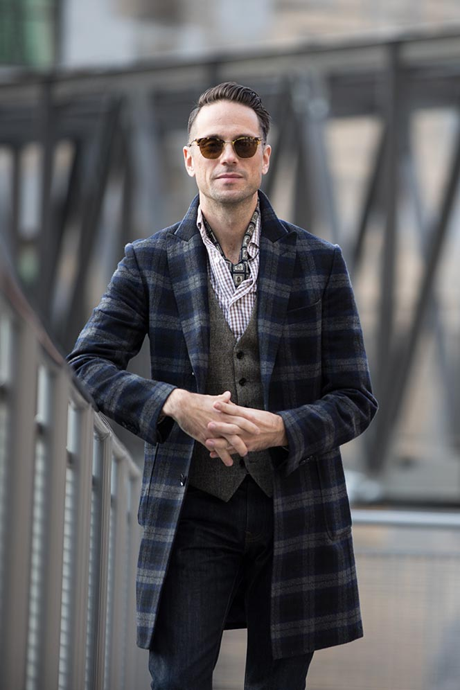 blue-plaid-coat-brown-gingham-shirt-vest-wearing-ascot-mens-sharp-casual-winter-outfit-ideas-with-boots-9