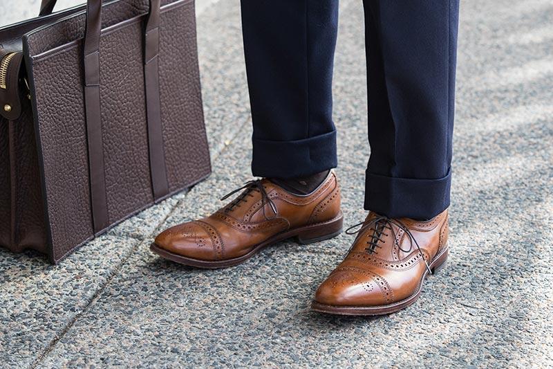 allen-edmonds-walnut-calf-strand-cap-toe-oxford-brogues-navy-pants-cuff-frank-clegg-chocolate-briefcase