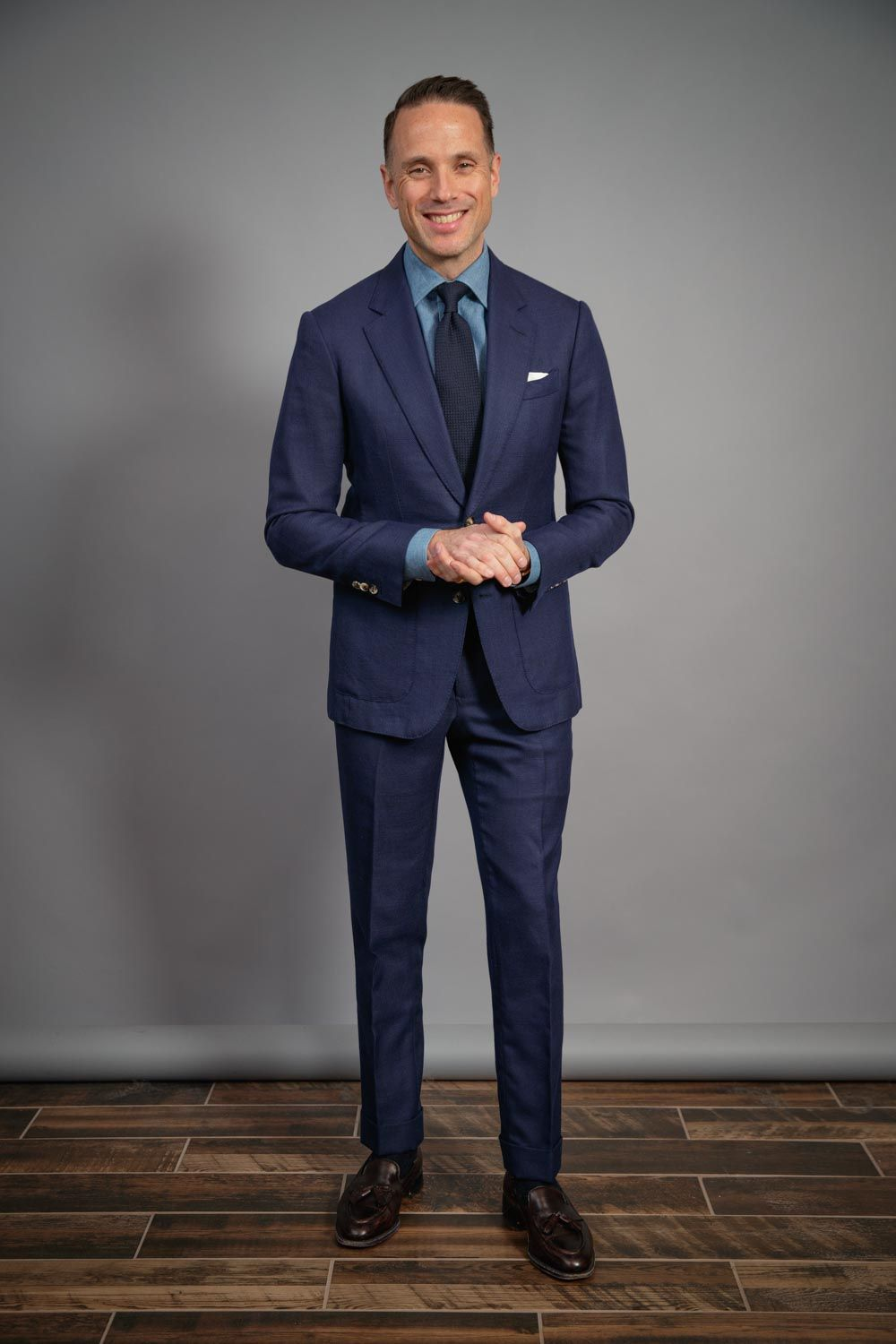 mens-capsule-wardrobe-navy-hopsack-suit-denim-shirt-tassel-loafers-grenadine-tie