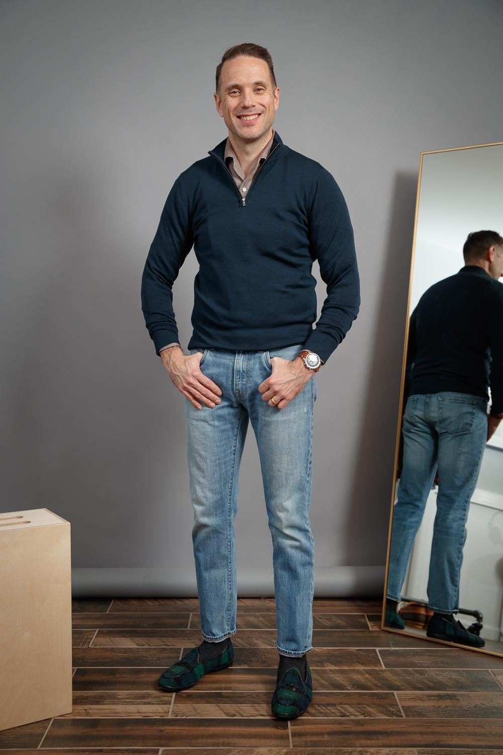 mens-casual-work-from-home-outfit-style-light-wash-jeans-brown-shirt-navy-zip-up-sweater-speedmaster-blackwatch-plaid-belgian-shoes